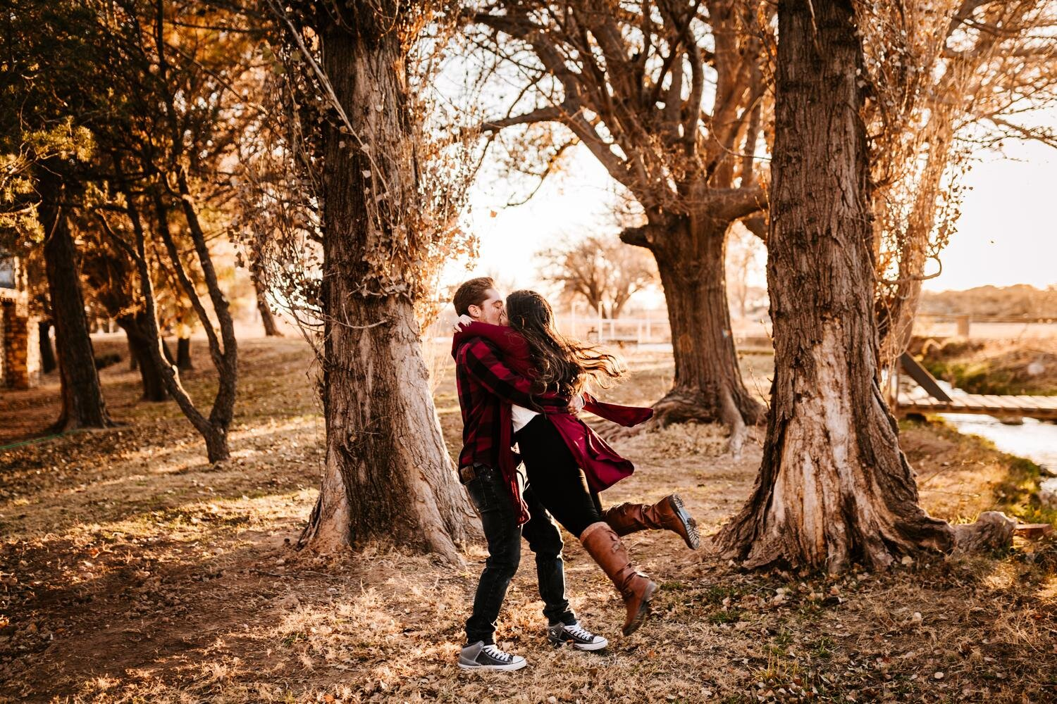 Girl flying into arms of husband in woods of New Mexico