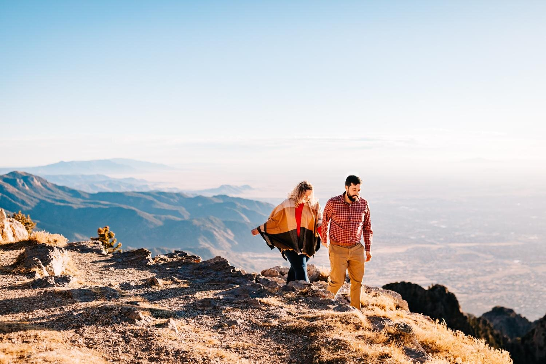 Couple walks hand in hand on ride at Sandia Peak, Albuquerque for engagement photos