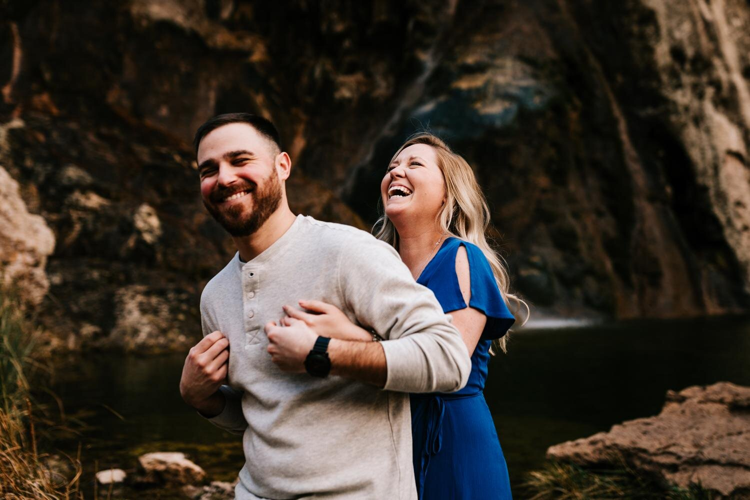 Couple laughing during engagement session in Carlsbad, New Mexico