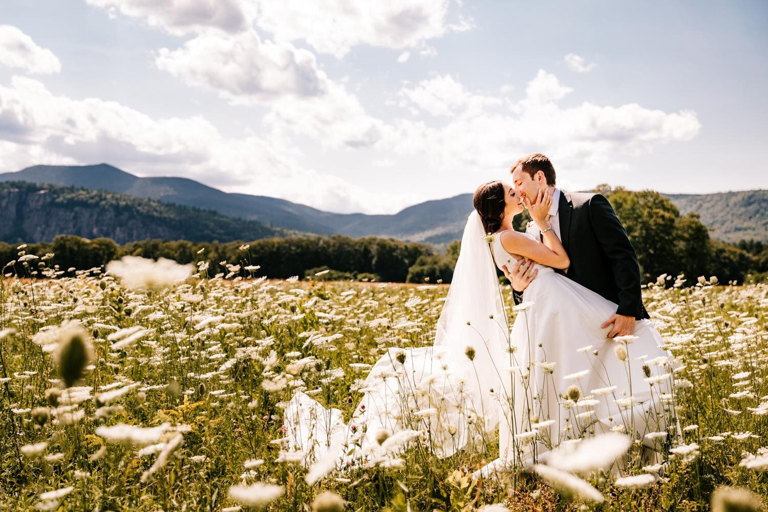 Bride and groom kissing in a wildflower field in Santa Fe, New Mexico