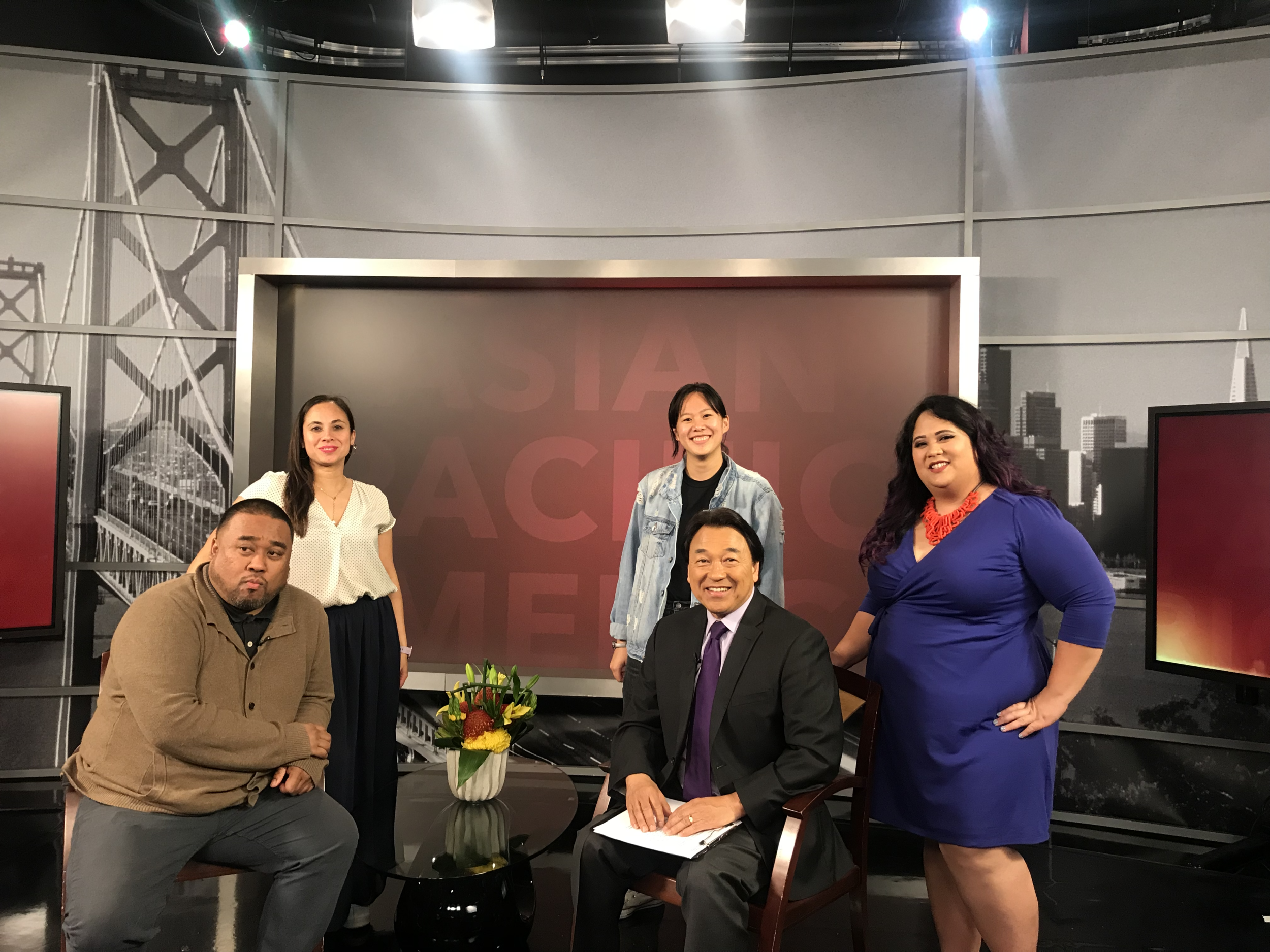 Jason Bayani (Poet, Kearny Street Workshop), Paloma Concordia (PapaLoDown Agency), Jenna Peng (PapaLoDown x APICC PR Intern), Robert Handa (Host, NBC News), and Melanie Elvena (API Cultural Center), on the set of NBC Bay Area for a tv interview on the program, 'Asian Pacific America'.