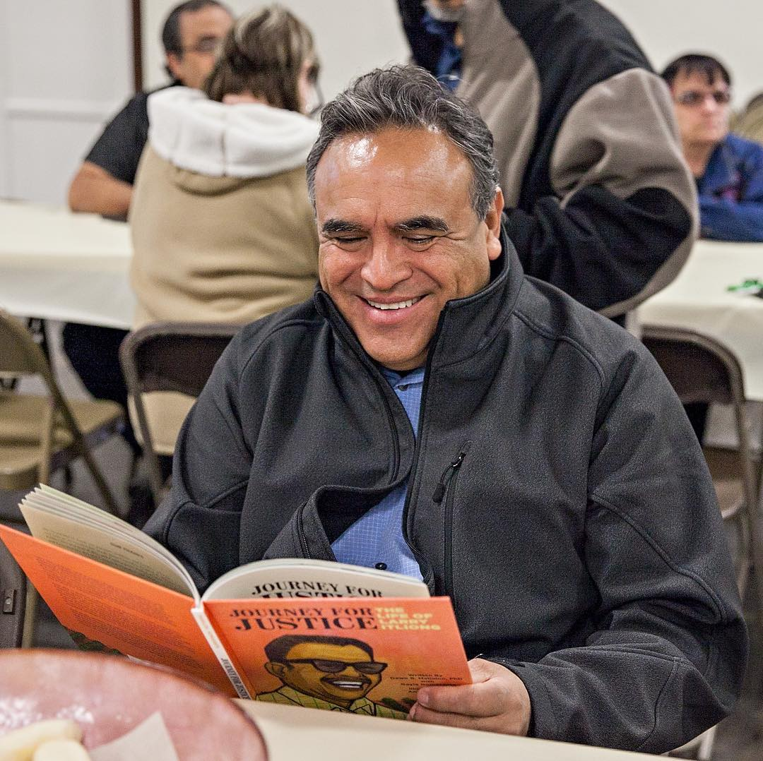 Emilio Huerta, lawyer and son of Dolores Huerta, reading Journey For Justice at the book tour kick off, February 2019, Delano, CA.