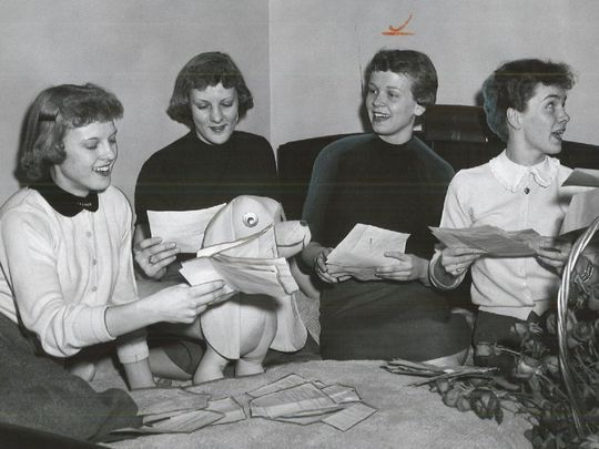 In this 1956 Register file photo, Carolyn Nicholson (far left) is reading a congratulatory telegram after the Maynard High School girls' basketball team won a state championship. A movie about Maynard's state title-winning season and Nicholson's life is being made. ( Photo: Register file photo )