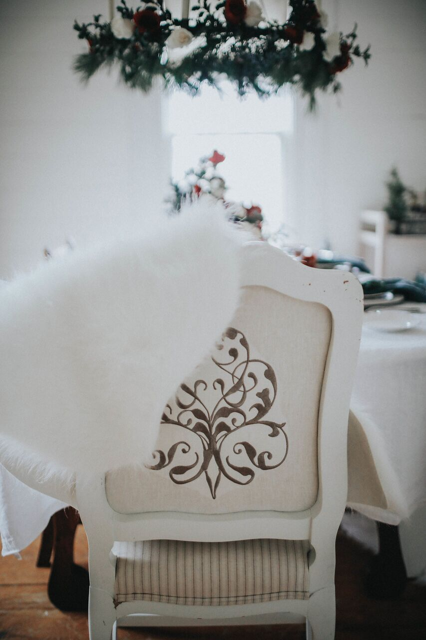 Holiday-Party- Scandanavian-table-decor-red-white-evergreens-sheepskin