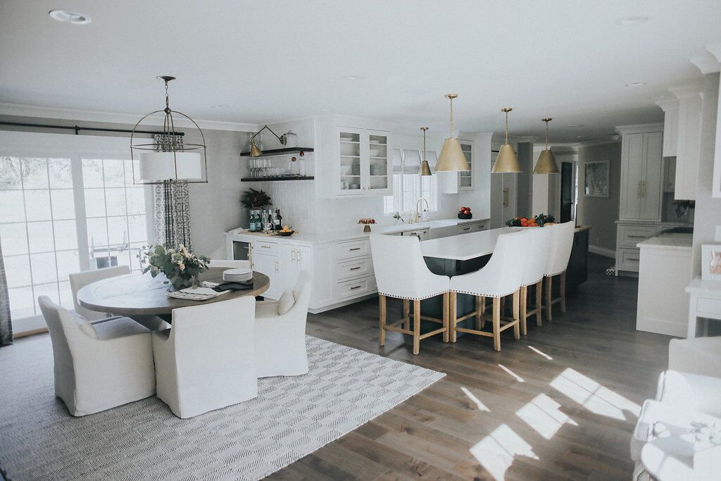 Kitchen with table  brass lighting barstools