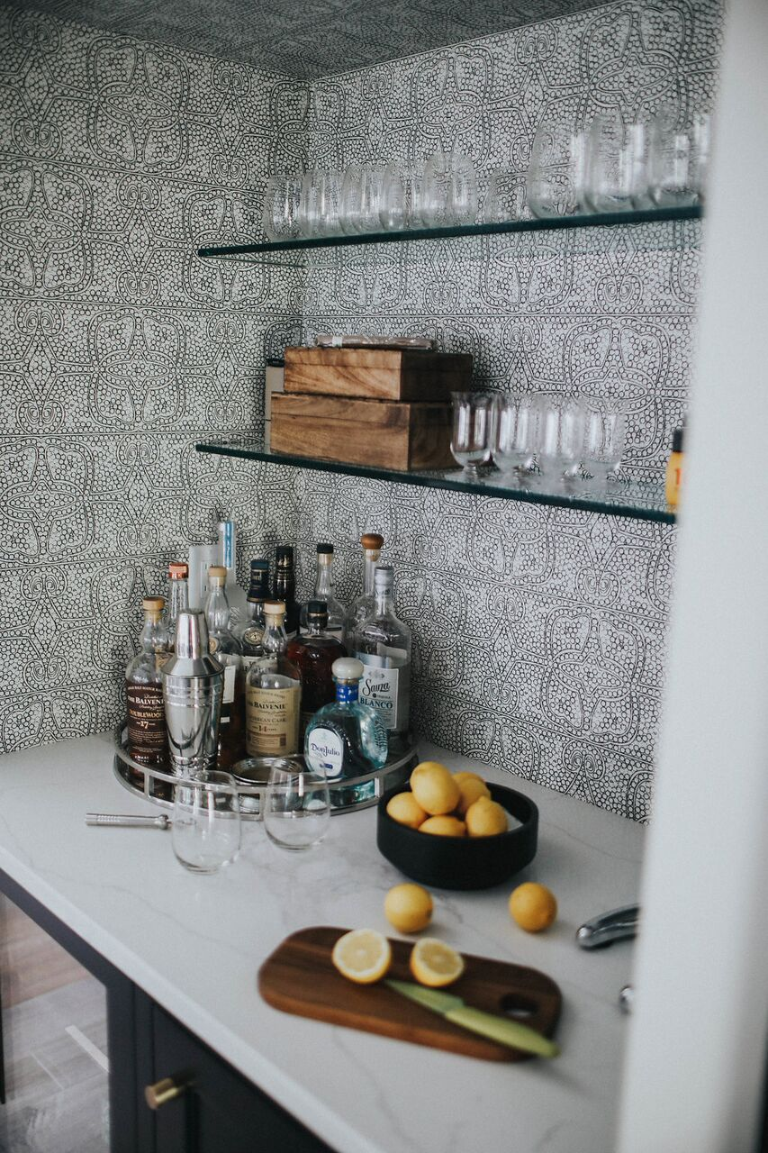 bar with wallpaper and glass shelves