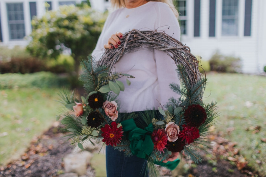 A Christmas wreath with fresh flowers