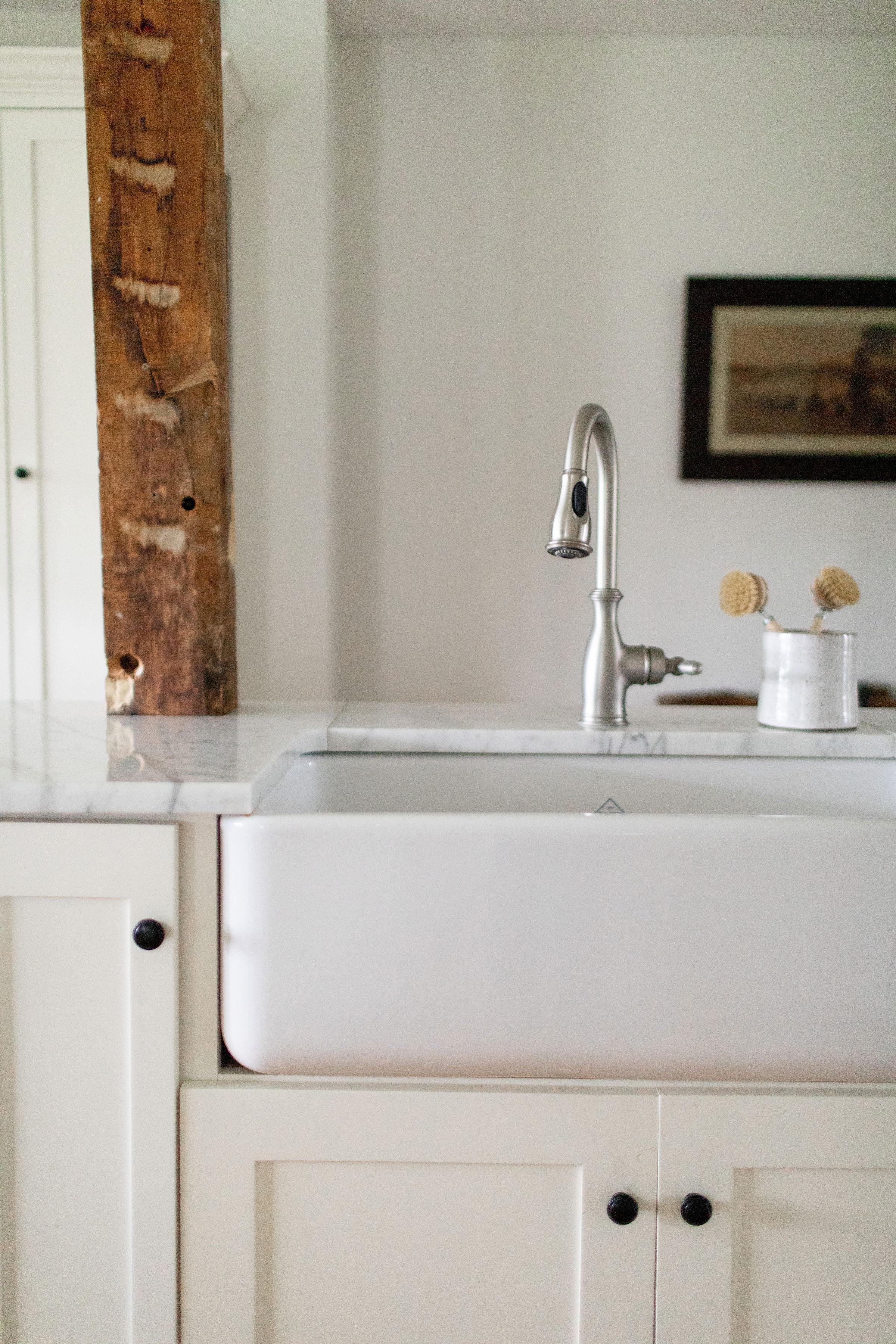 White kitchen with wood beam NY interior designer