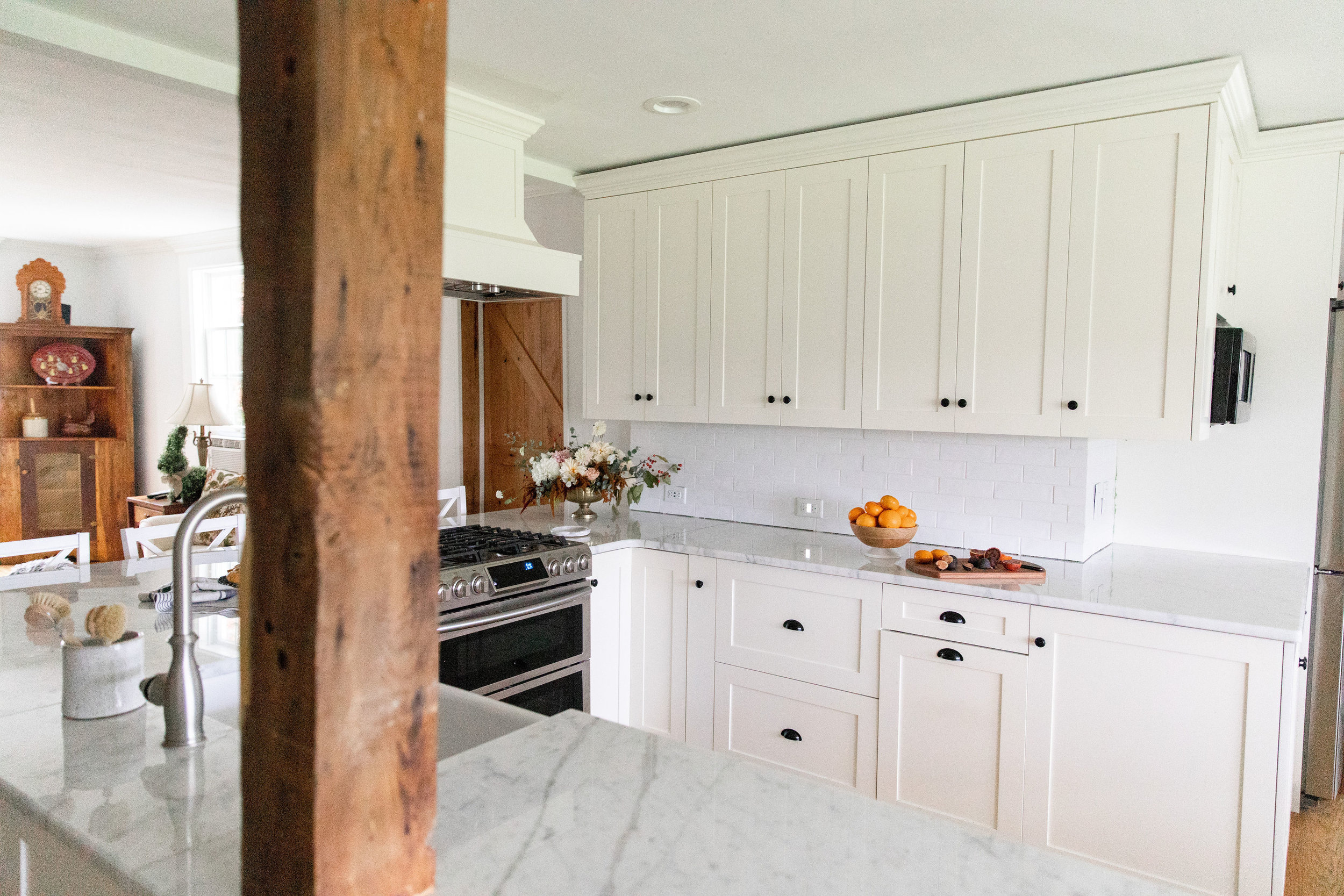 Small white kitchen with wood beam accent