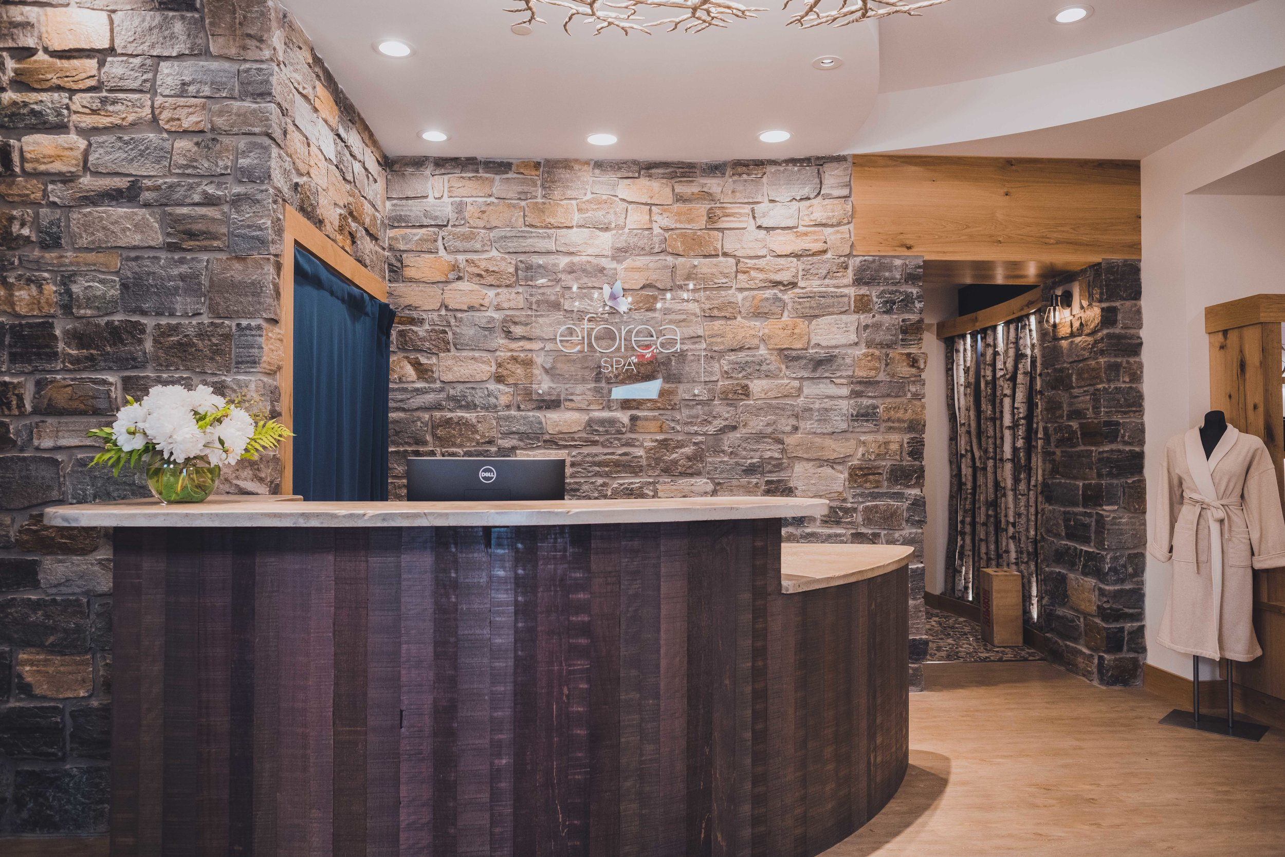 The modern rustic design of the Tailwater Lodge front desk
