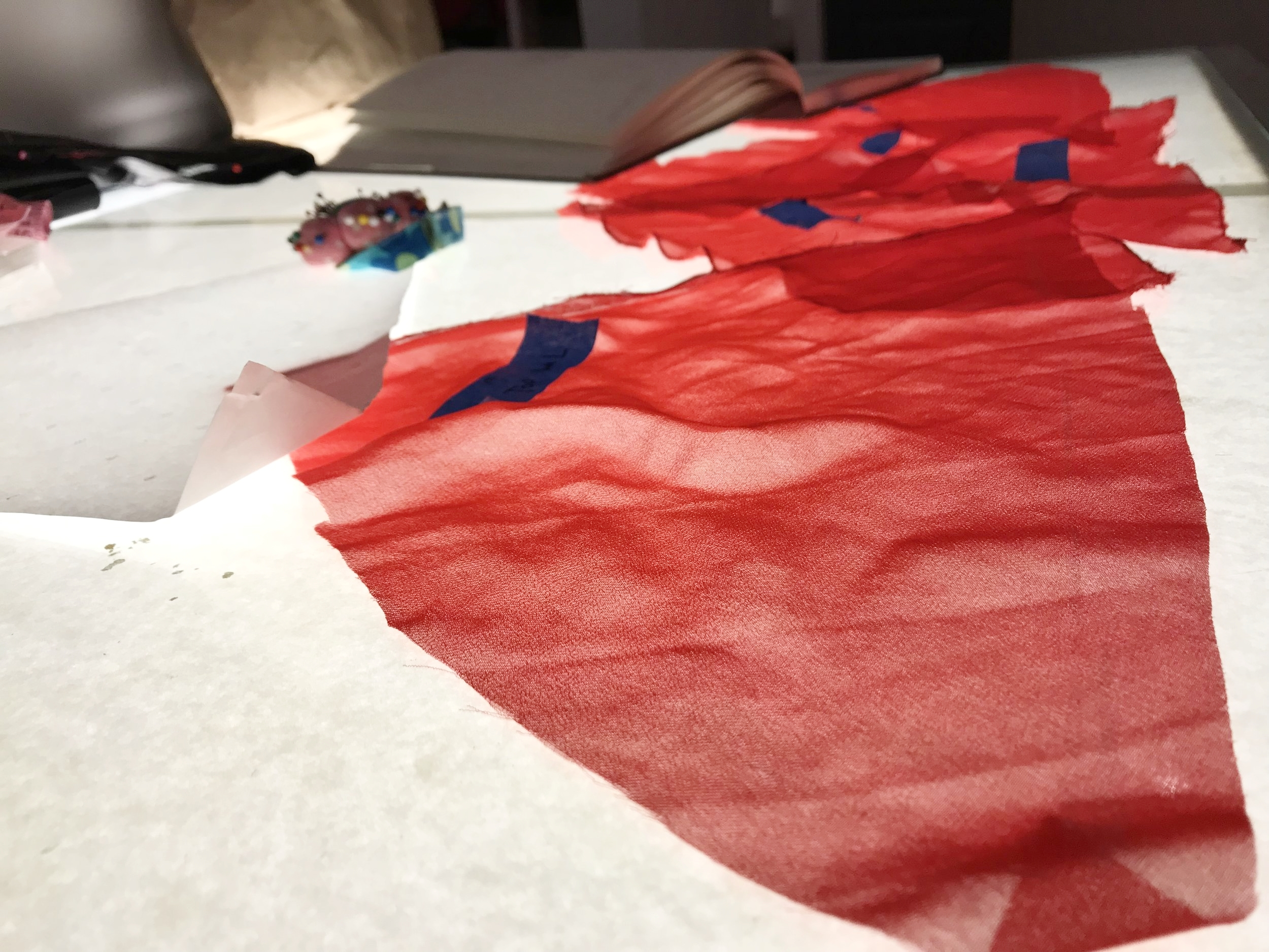 Patterns for a red sheer dress, one of the garments in Hidalgo's upcoming collection.