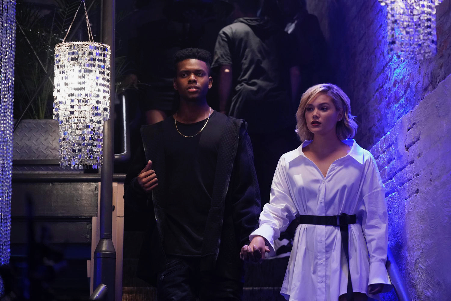 Aubrey Joseph as Tyron, Olivia Holt as Tandy in Cloak & Dagger Season 2  Alfonso Bresciani/ ©️2018 Disney Enterprises, Inc.    Season 2 turns the heat up on our young heroes, as Tyrone and Tandy try to find their place as more active heroes in this world. As they learn and grow emotionally, so will their skills. We saw Tandy and Ty dip their toes into the world of hopes and fears; this season, they will dive deeper into this metaphysical pool. With enhanced powers and a choice to make about the type of heroes they want to be, they make the choice to run into the danger, head first. They tackle a heartless vigilante and uncover an evil that's been preying on the young women of the city, as the show takes on more serious topics like gang violence and human trafficking.