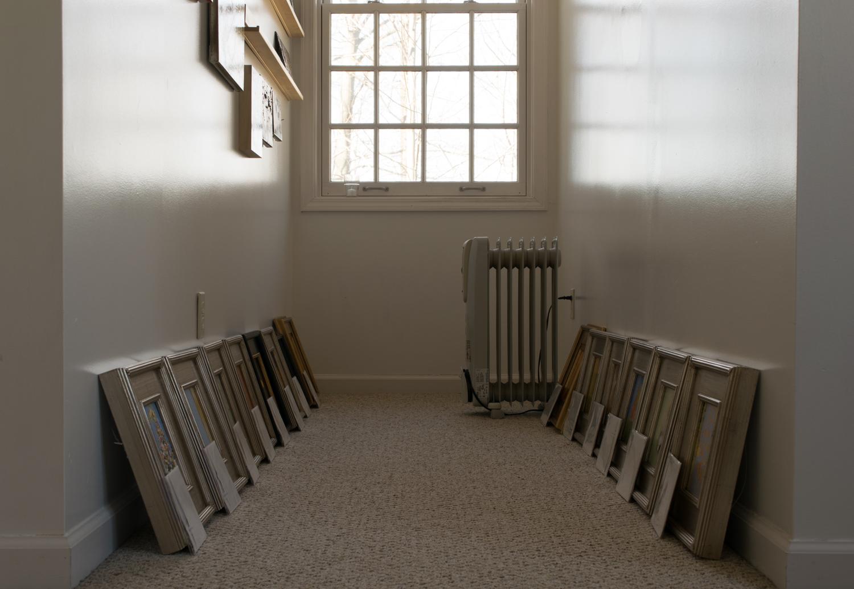 framed paintings and oil heater.jpg
