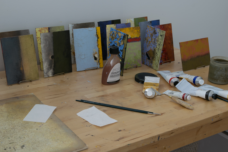 signing new paintings.jpg