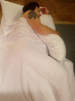 A client in side lying position for a prenatal massage at Monarch Massage Therapy dc