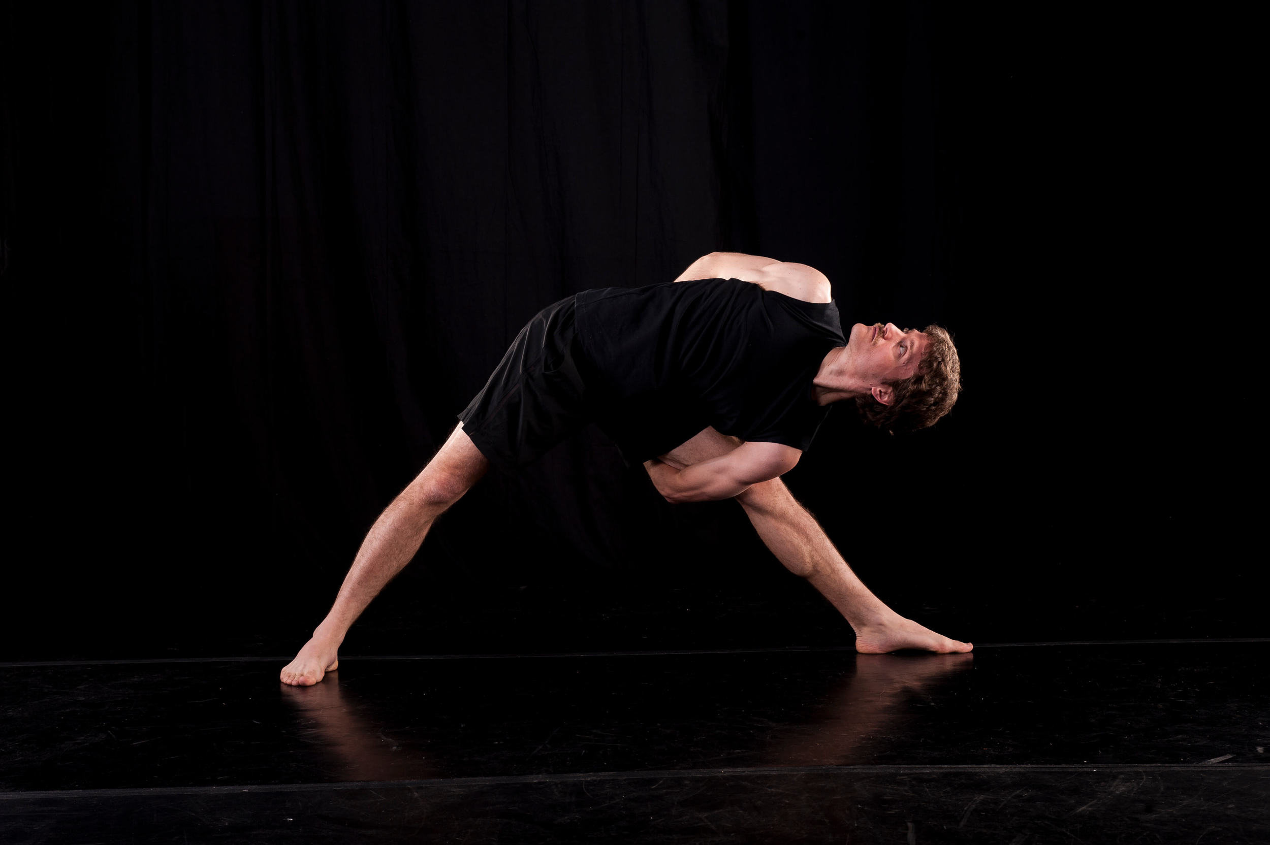 Stephen in triangle yoga posture