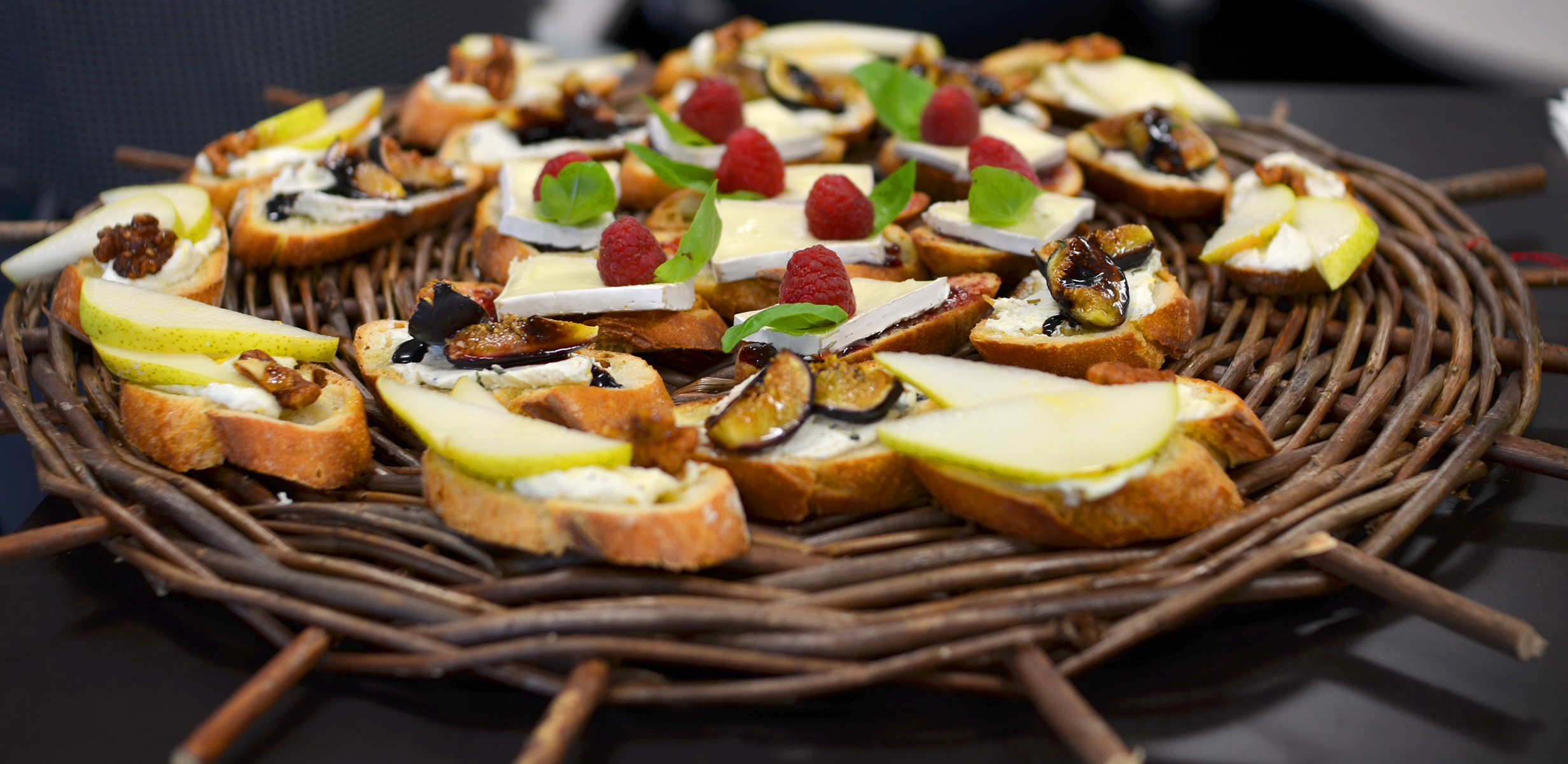 Assorted crostini: Gorgonzola fig with balsamic glaze, Raspberry brie, & Lemon zest ricotta with pear, glazed walnut, and honey drizzle.