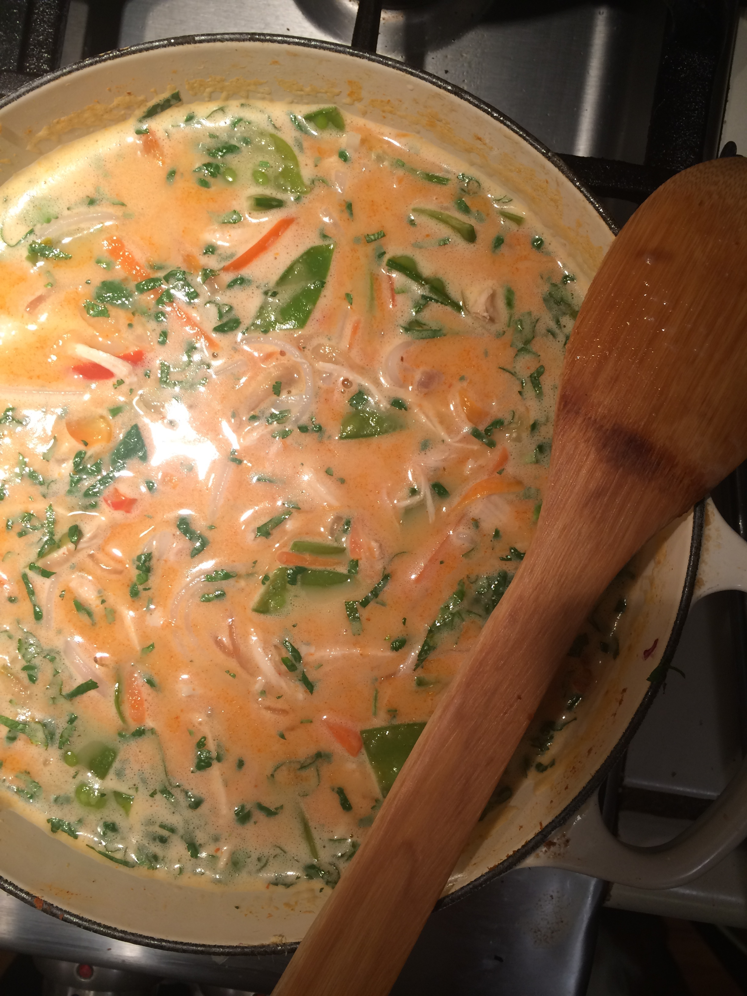 Once the broth mixture has come to the low boil, add the coconut milk, stirring to combine and bring back to temperature. Add shredded chicken, noodles and vegetable at this point. Let the mixture simmer on low until veggies are heated(about 10 minutes) and the flavors are absorbed into the noodles.