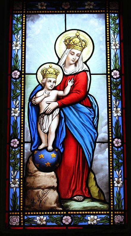 A stained glass window of Our Lady of Victory.