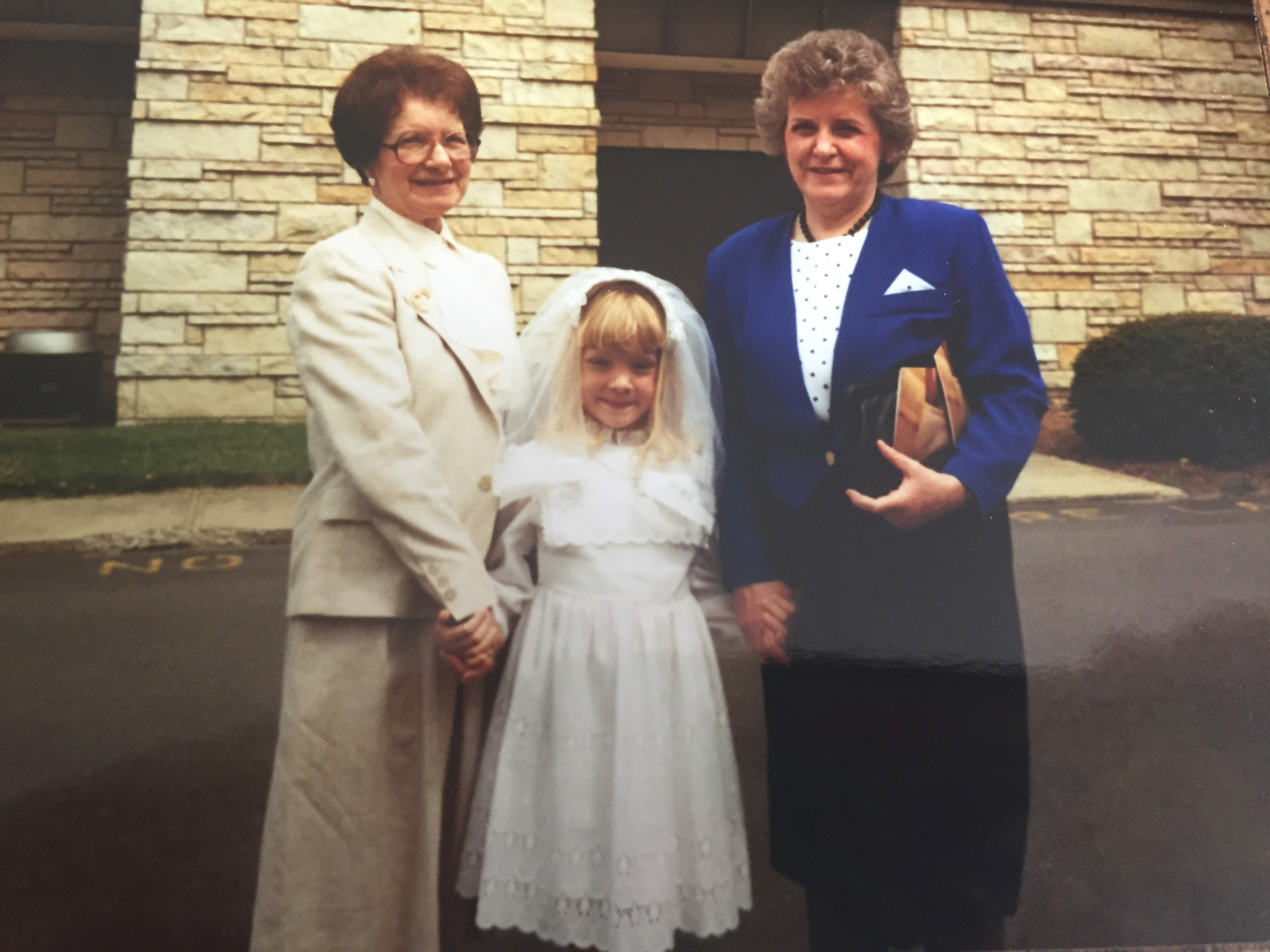 My First Communion, April 1990, with my grandmothers: Grandma D is on the left, and Grandma H is on the right.