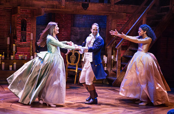 Phillipa Soo (Eliza Hamilton), Lin-Manuel Miranda (Alexander Hamilton), and Renee Elise Goldsberry (Angelica Schulyer Church) in a scene from  Hamilton .
