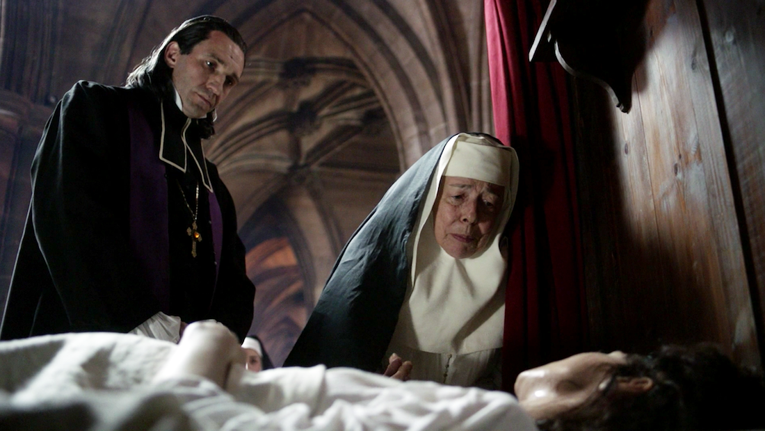 """A scene from  Outlander , Season 2, """"Faith"""", right before Claire (Caitrione Balfe) receives anointing."""