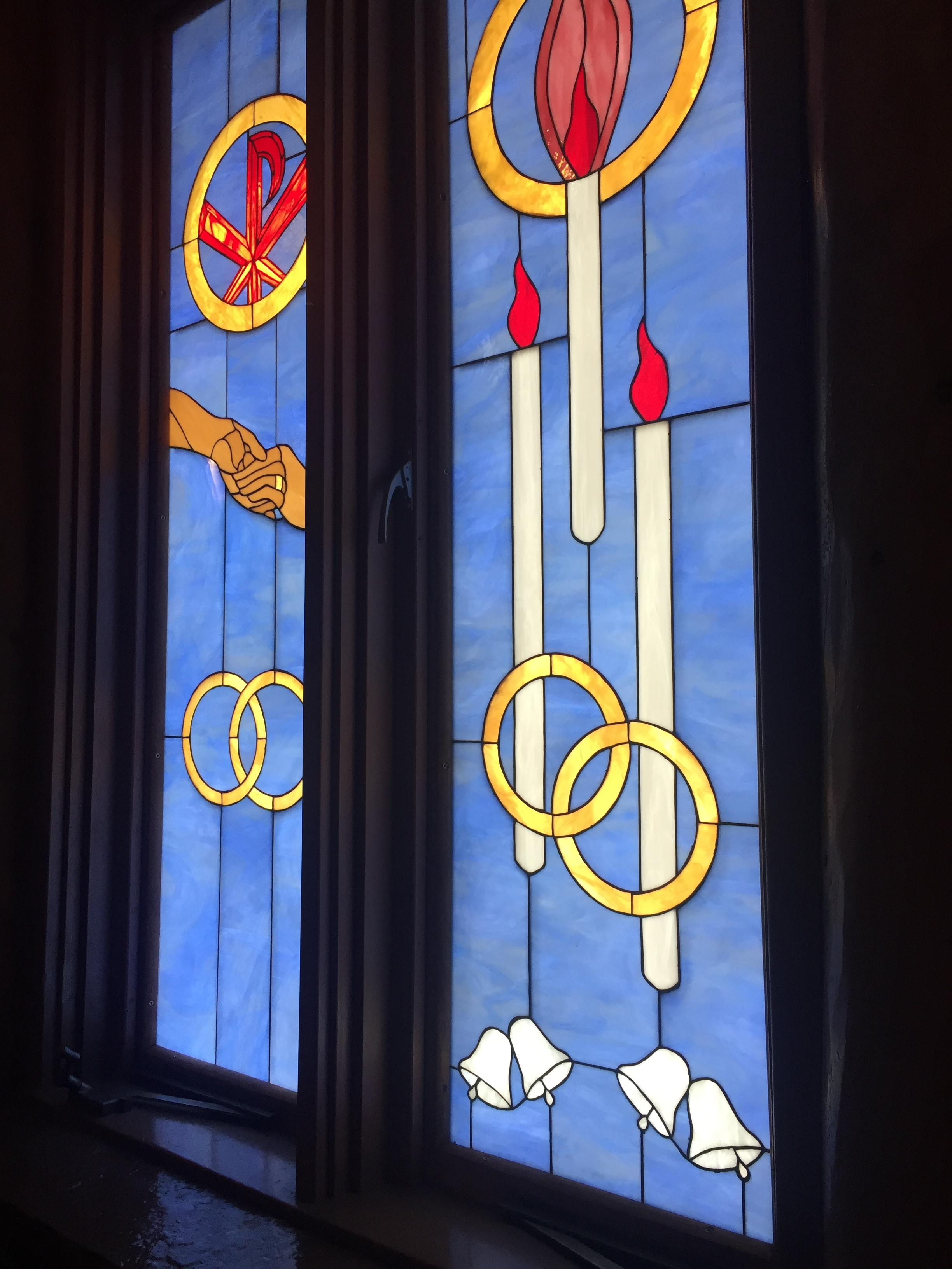 The stained glass windows around the nave showcased the sacraments. Thought this one was especially appropriate!