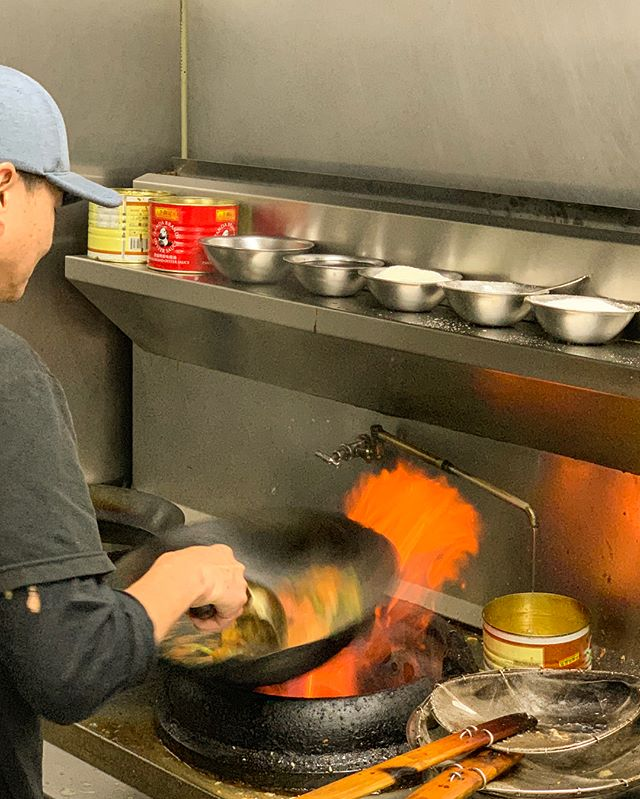 Some behind-the-scenes snaps of our head chef, Mun, cooking up some chili prawns during this evening's dinner service.