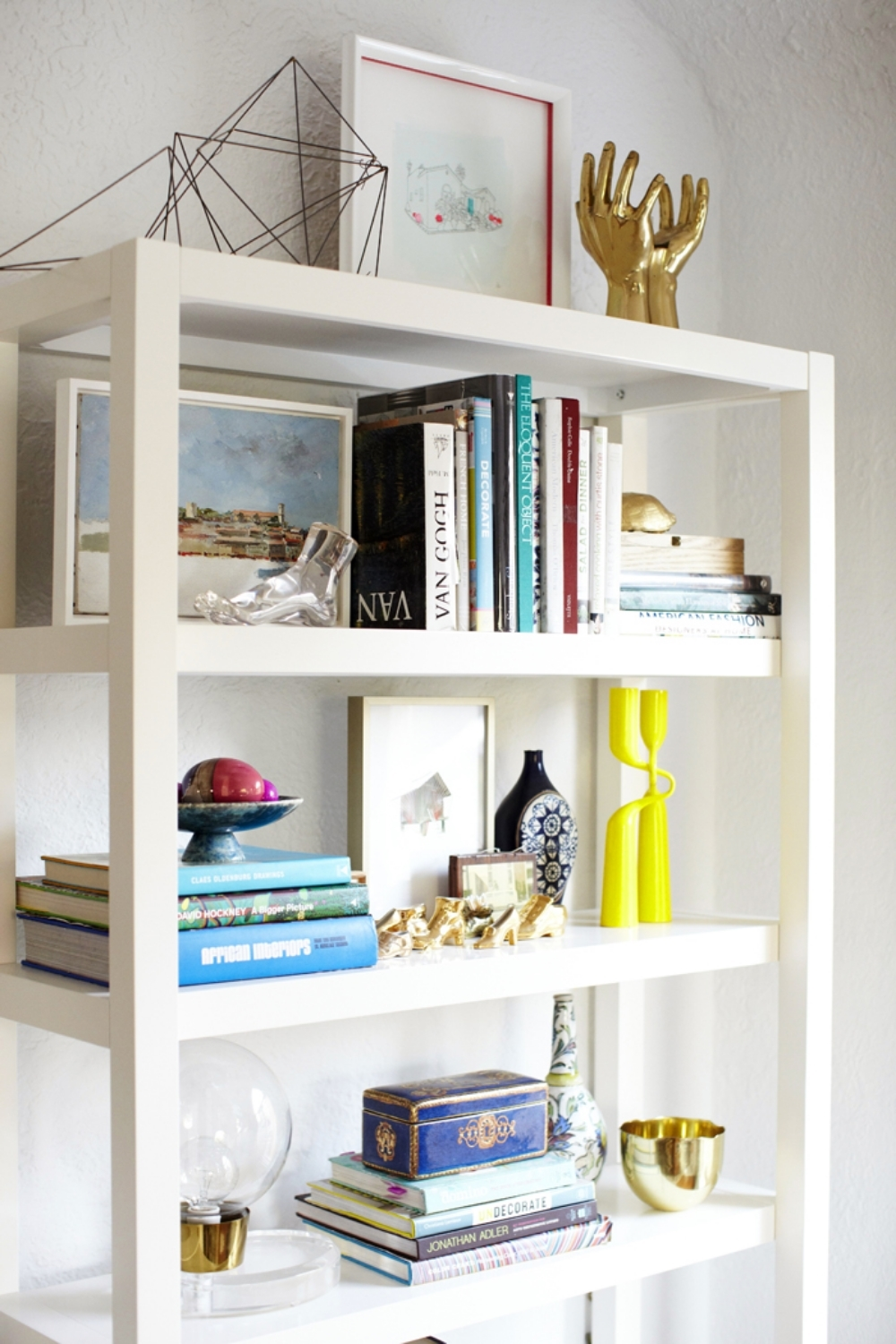 Shelfie by Emily Henderson (see golden hands top right).