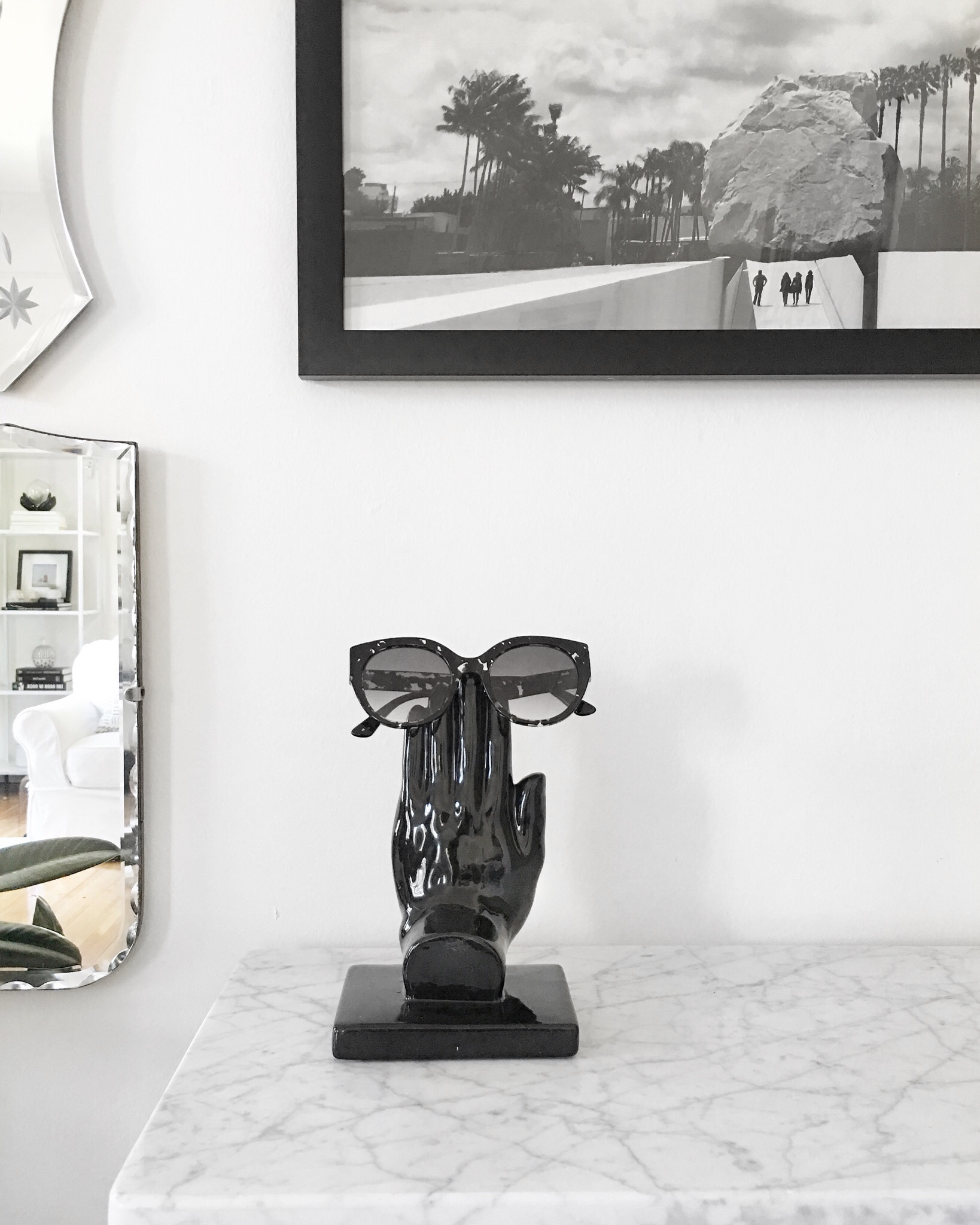 Black ceramic bookend re-purposed as a sunglasses holder and a closer look at the quality of the Framebridge iPhone photo print.