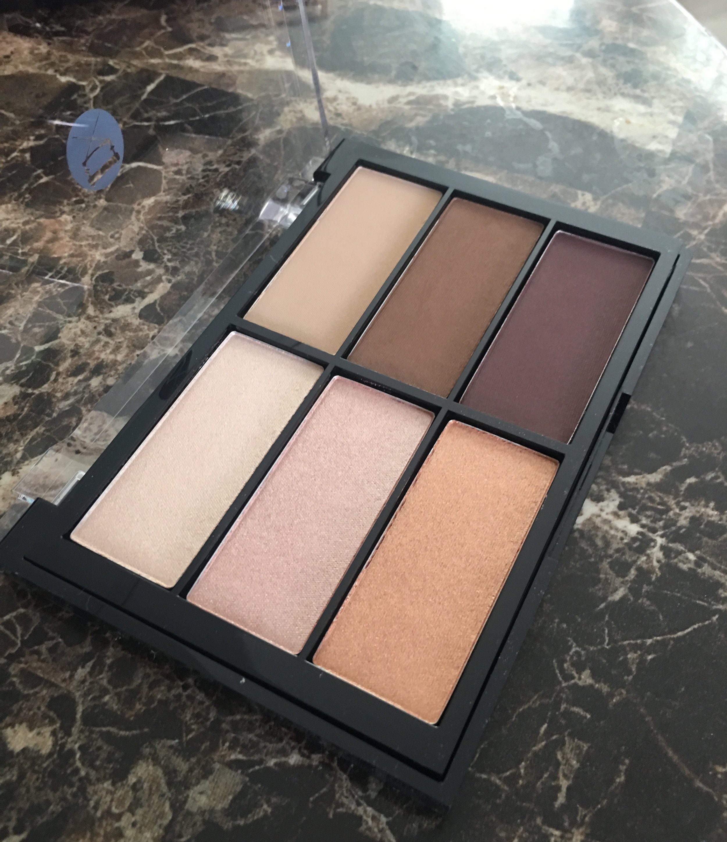 My Viseart palette when it was brand new. On Lindsey I used the top two highlight and top two contour shades.