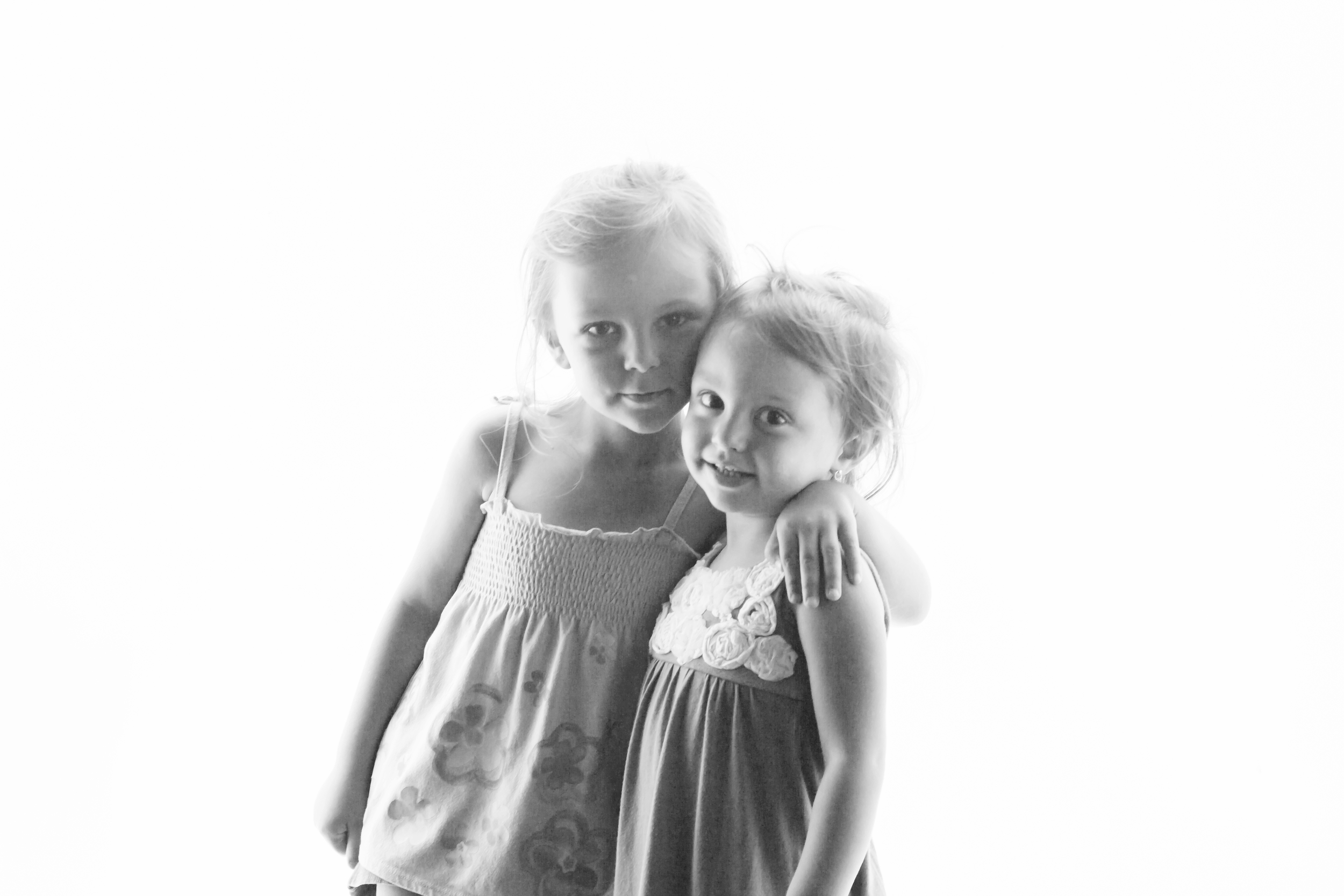 Our oldest, William, took this photograph of the two youngest, Lily and Sadie.  The color was very blue due to the lights in the Texas State Aquarium, but he changed it to black and white.  Don't be afraid to experiment and get creative!