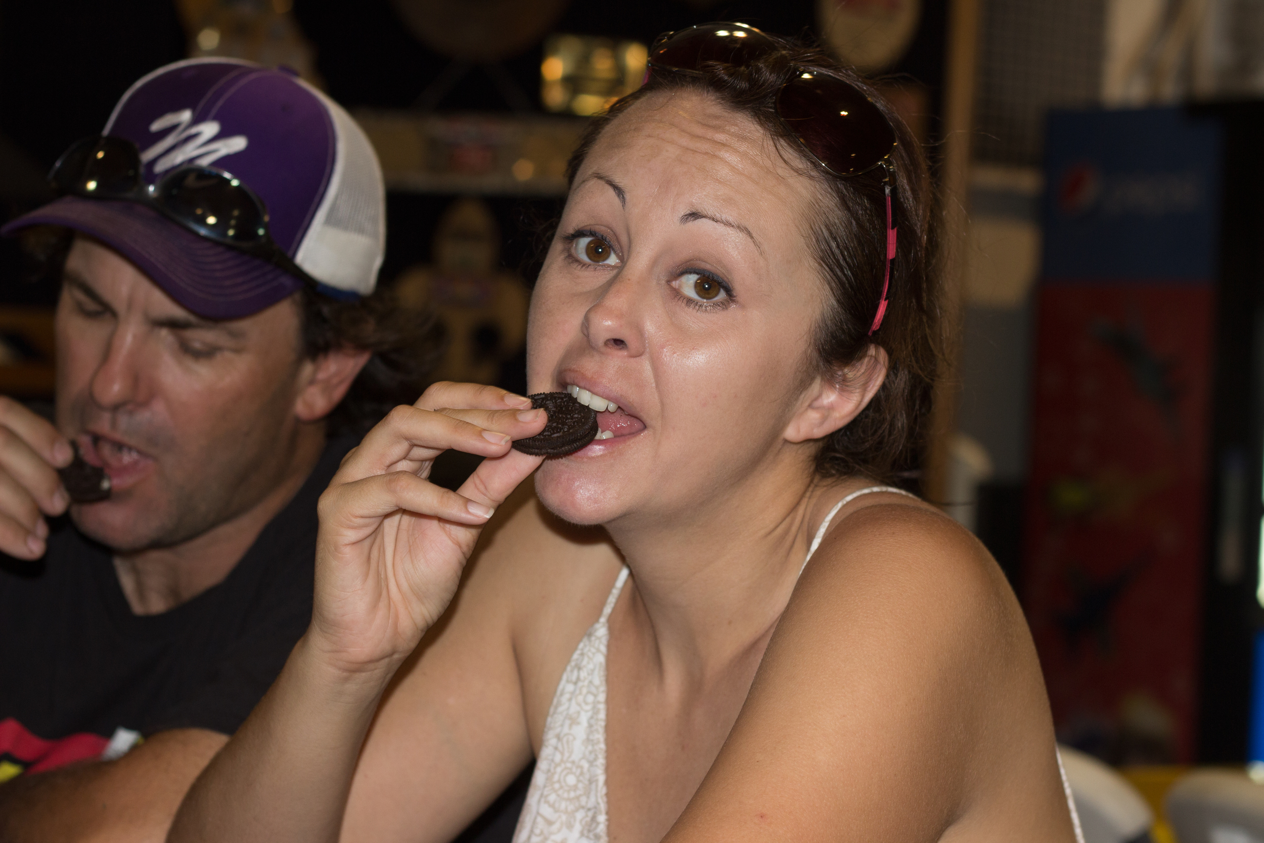 Candid photographs of me and my husband, John, eating Oreos while visiting the USS Lexington.