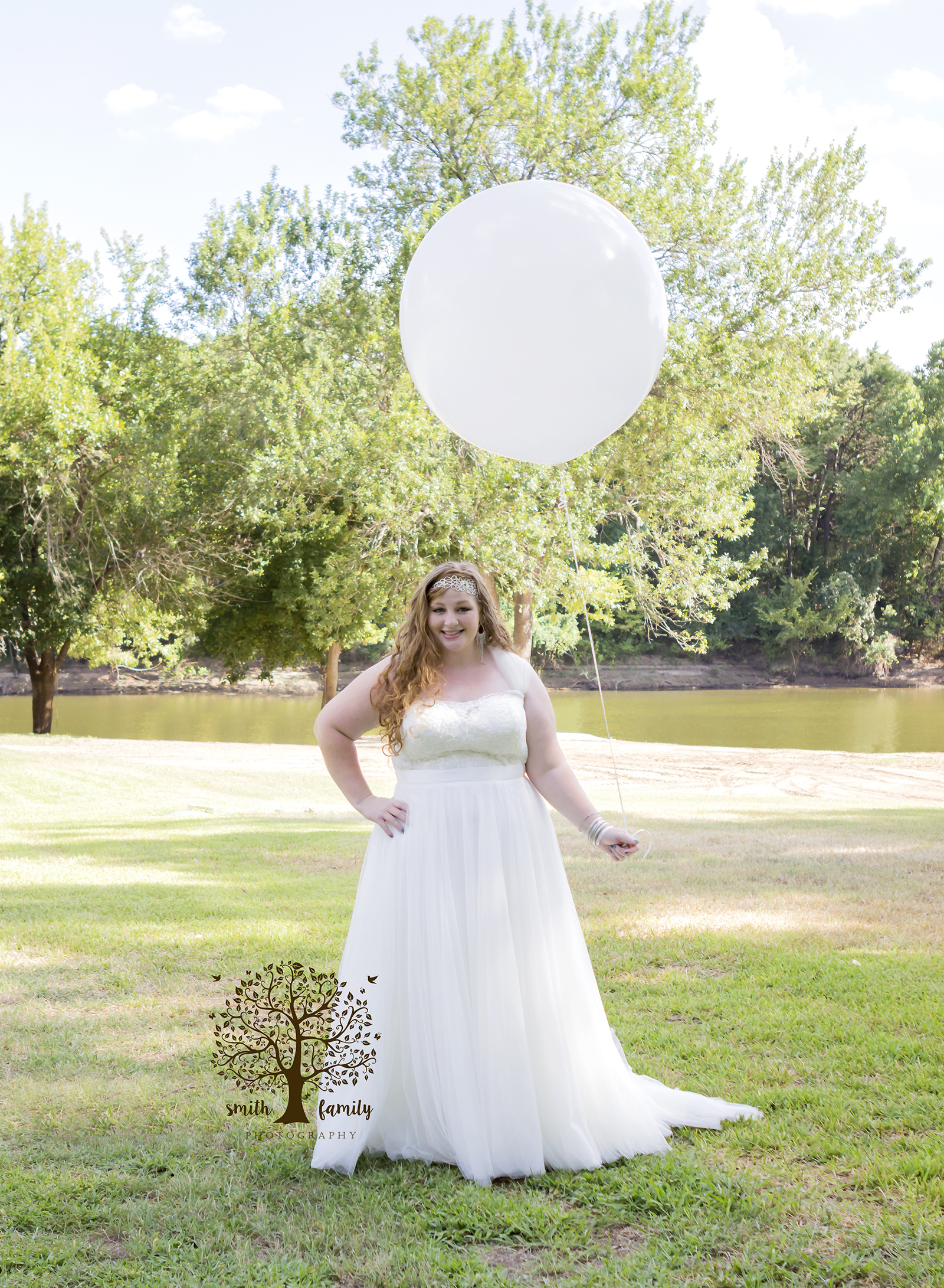 Kia and Madison chose a location on the banks of the Brazos River in Waco, Texas for their backyard wedding.  Photo credit:  Amber Payne for Smith Family Photography