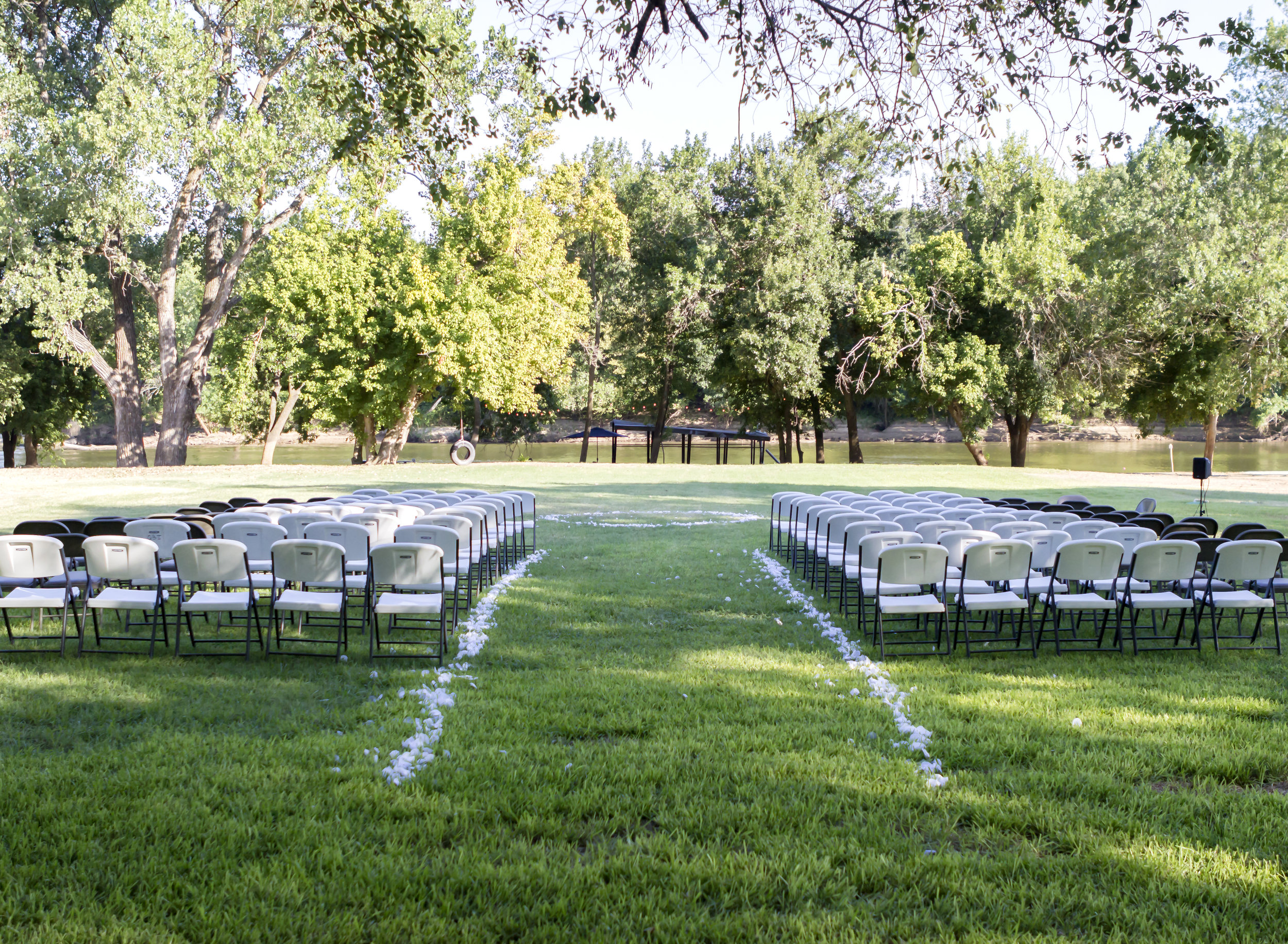 This backyard is very large, which allowed Kia and Madison to designate areas for different parts of their big day.  There was a setup for the ceremony and after the ceremony, everyone gathered at the nearby tables, patio, and house for the reception.  Photo credit:  Anna Johnson-Smith for Smith Family Photography