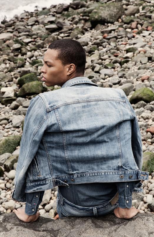 Scott Camaran wears a denim jacket from WHO.A.U. Denim shirt; Tommy Hilfiger. Jeans; Diesel. Glasses; 3:1 Phillip Lim. Bag; Model's Own.