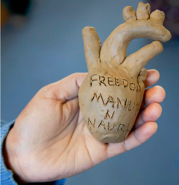 One of 1,468 ceramic hearts from Penny Ryan's  Confined Hearts  project, made by volunteers and inscribed with their messages. Photograph: David T Young