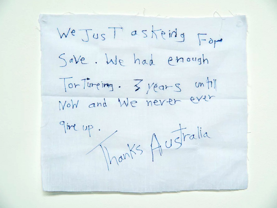 'We just asking for save. We had enough torturing.':  A message from a detainee on Manus Island .  Photograph: David T Young/ Penny Ryan