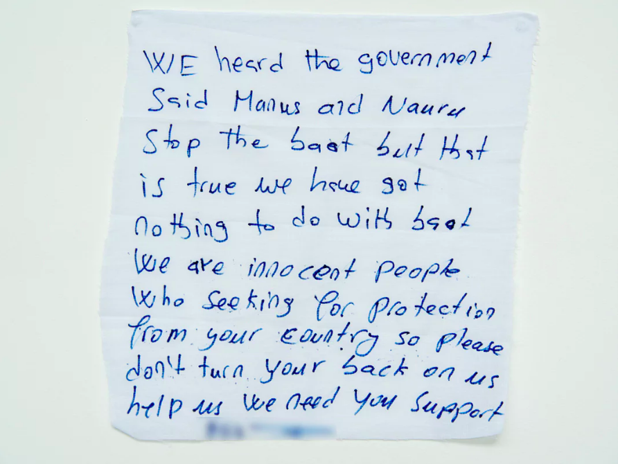 'We are innocent people':  a message from a detainee on Manus Island .  Photograph: David T Young/ Penny Ryan