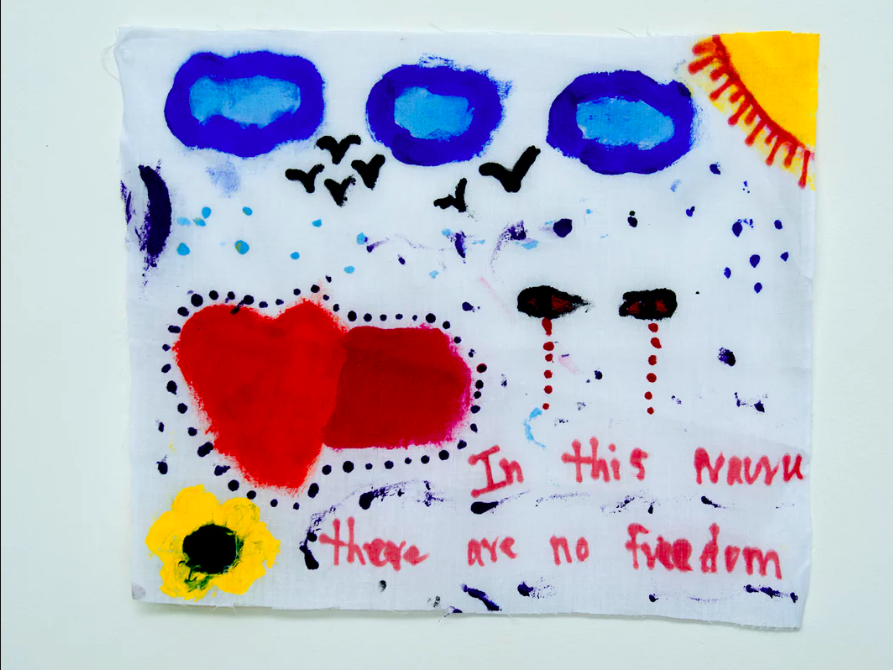 'In this prison there are no freedom':  a message message from a detainee  on Nauru.  International governments  and human rights groups including Amnesty International, the UN and Human Rights Watch have repeatedly criticised Australia's policy of offshore detention.  Photograph: David T Young/ Penny Ryan