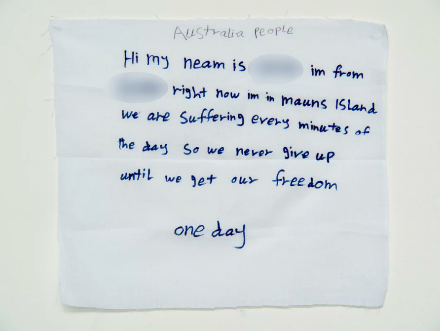 'We are suffering every minutes of the day so we never give up':  a message from a detainee  on Manus Island.  Photograph: David T Young/ Penny Young