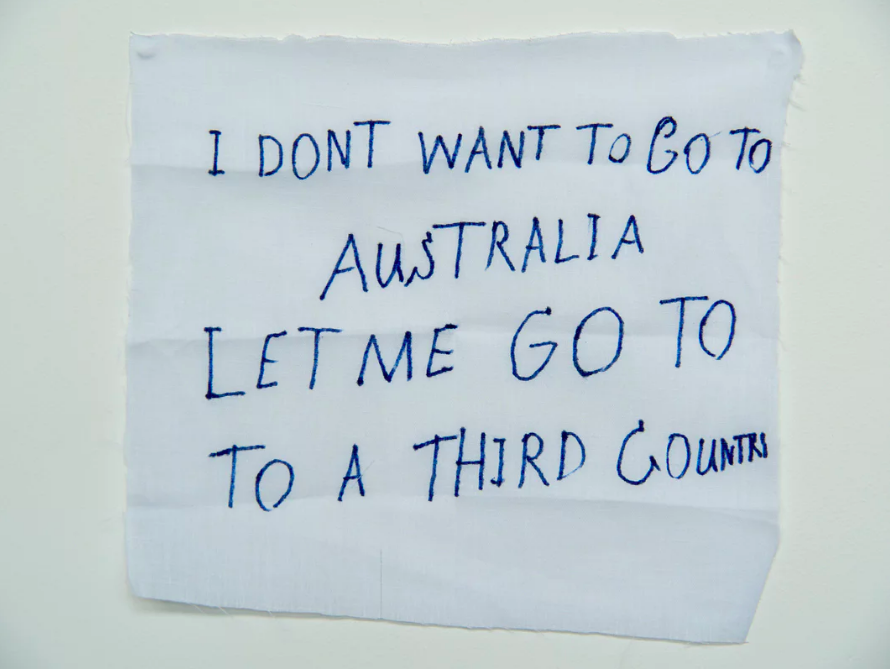 'I don't want to go to Australia':  a message from a detainee on Manus Island .   Photograph: David T Young/ Penny Ryan