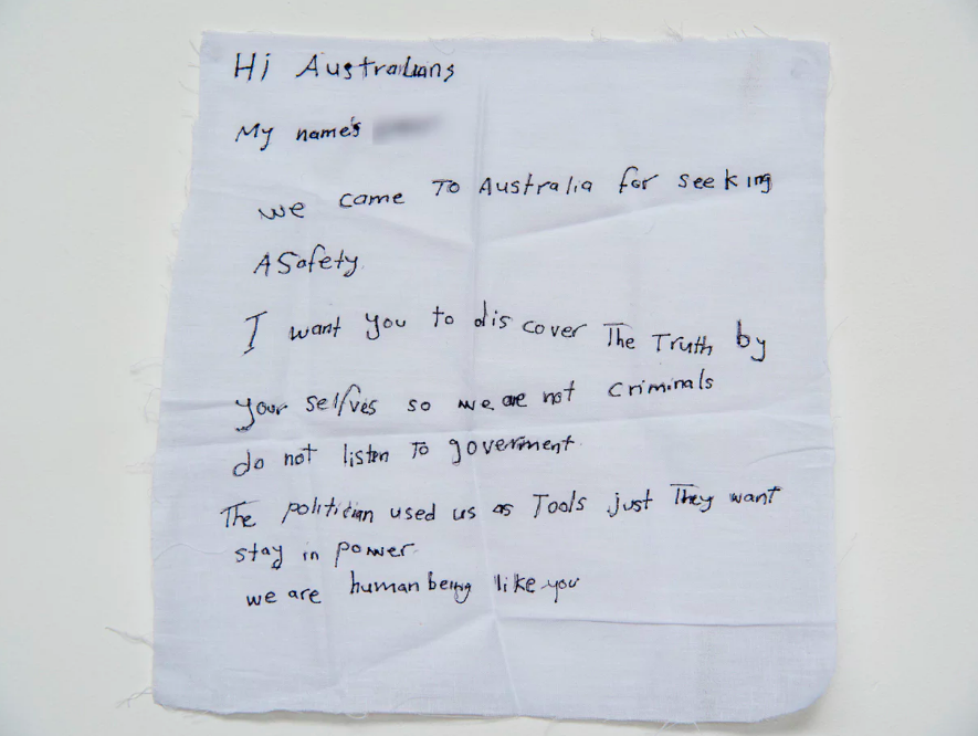 'We came to Australia for seeking safety … We are not criminals': a handwritten note from  a detainee on Manus Island .  Photograph: David T Young/ Penny Ryan