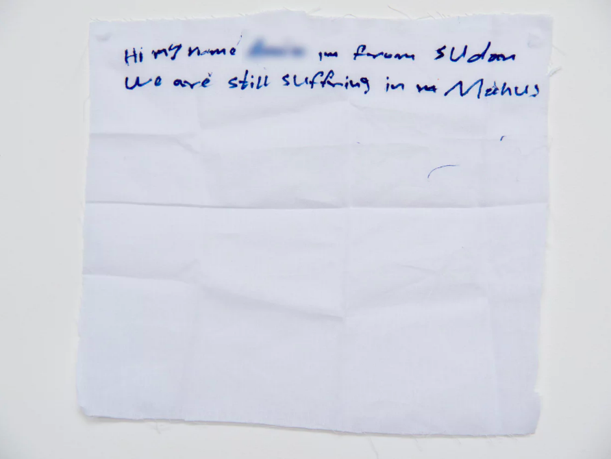 'We are still suffering': a hand written note from  a Sudanese detainee on Manus Island .   Photograph: David T Young/ Penny Ryan