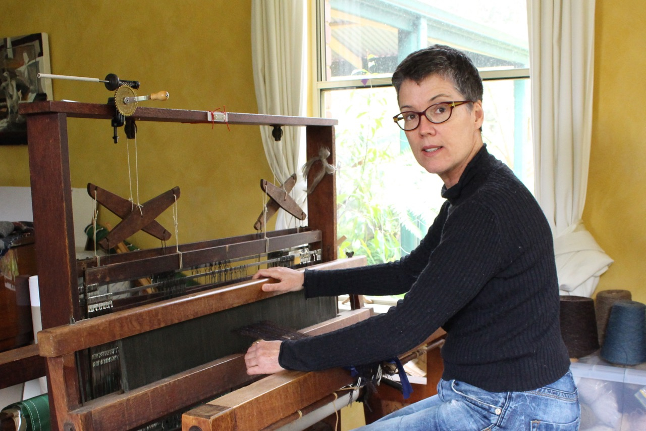 In the studio, weaving on my War Widows' Craft Guild loom.