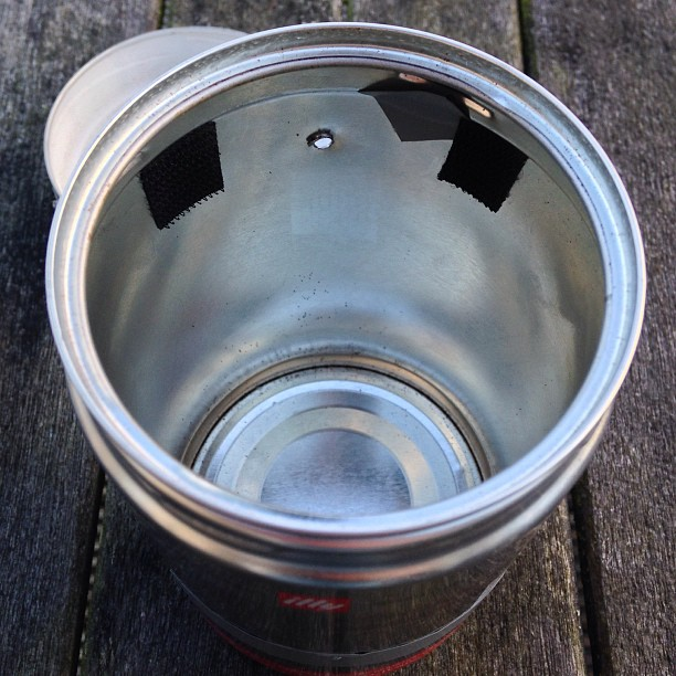 Showing hole drilled near top of tin with Velcro fasteners