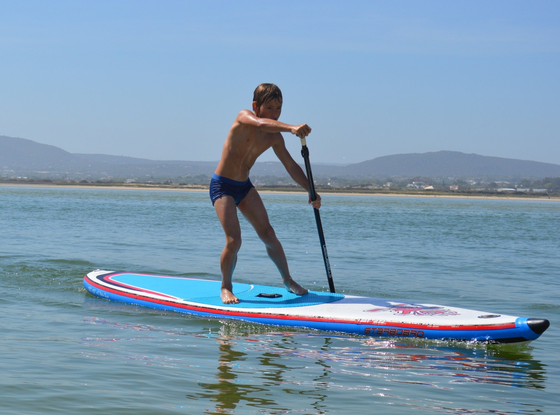 Future champion practicing his SUP racing technique.