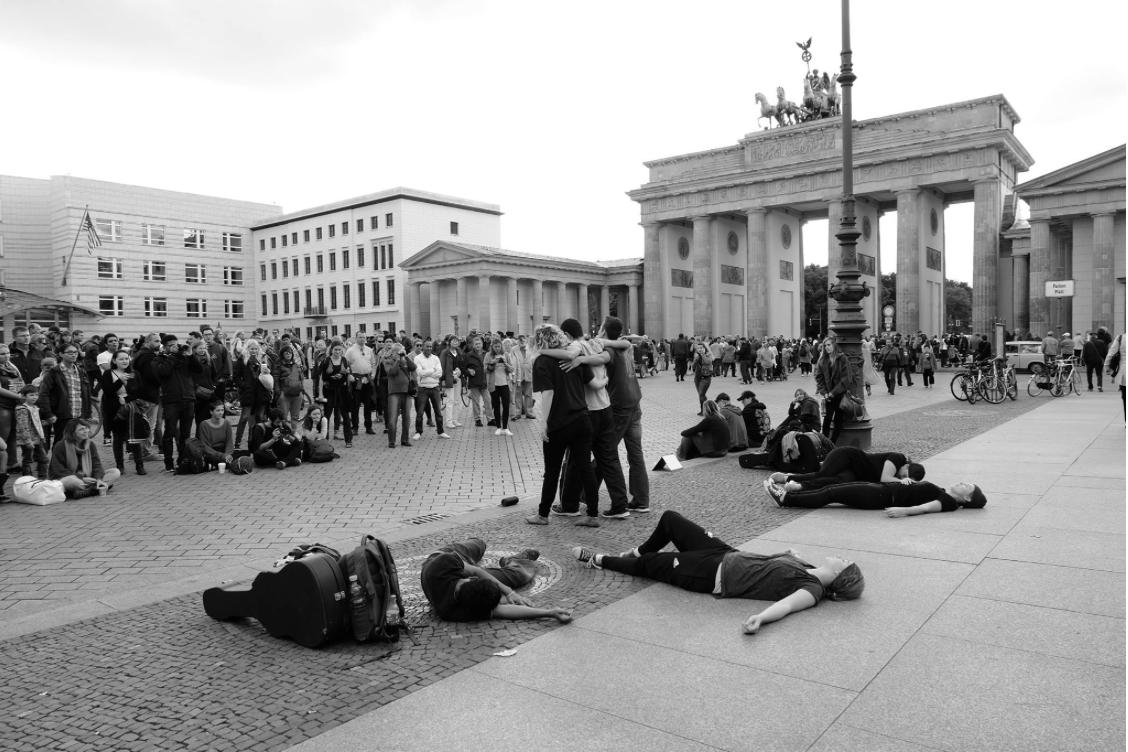 Team performing in front of the Brandenburg Gate, Berlin