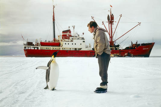 Physicist, Jeremy T. Bailey, consults a local for directions to the South Pole.