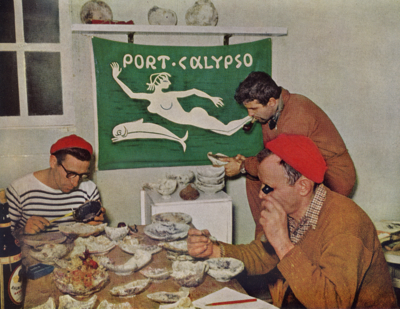 Jacques Cousteau and crew examine Italian pottery discovered in a 2,200 year old Greek ship (January, 1954).